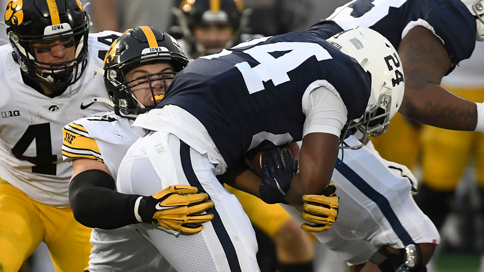 Iowa defensive lineman Zach VanValkenburg (97) tackles Penn State running back Keyvone Lee