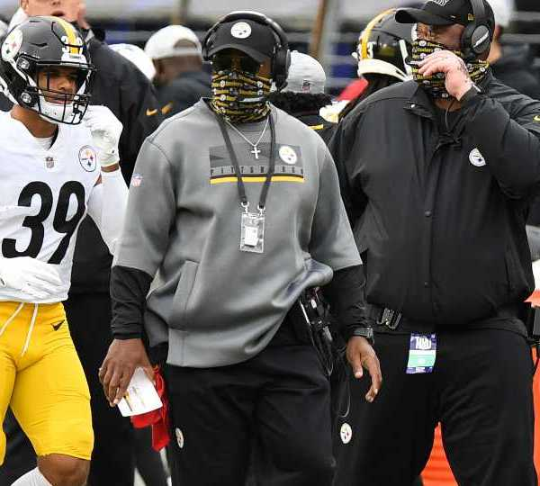 """FILE - In this Sunday, Nov. 1, 2020 file photo, Pittsburgh Steelers head coach Mike Tomlin looks on during the second half of an NFL football game against the Baltimore Ravens in Baltimore. A person with knowledge of the matter told The Associated Press that Tomlin has been fined $100,000 and the club $250,000 because coaches improperly wore facial coverings last Sunday. The person said Friday, Nov. 6 that Tomlin and the Steelers were disciplined because members of the coaching staff were """"not wearing face coverings at all times on the sidelines."""""""
