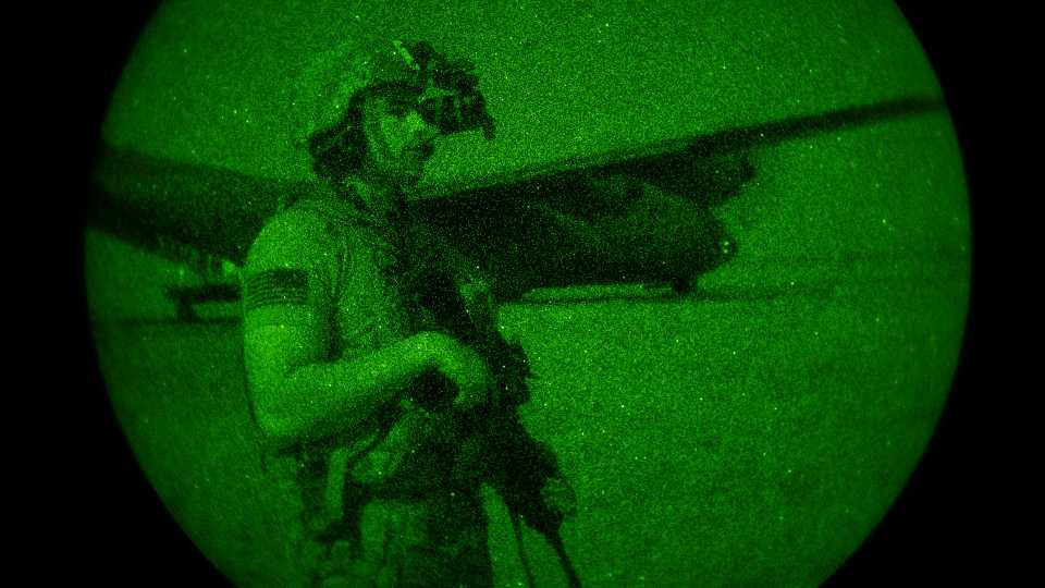 U.S. Army Spc. Dominic Deitrick, assigned to the 1-186th Infantry Battalion, Task Force Guardian, Combined Joint Task Force - Horn of Africa, seen through a night-vision device, provides security for a 75th Expeditionary Airlift Squadron (EAS) C-130J Super Hercules during unloading and loading operations Friday, June 12, 2020 at an unidentified location in Somalia. No country has been involved in Somalia's future as much as the United States but now the Trump administration is thinking of withdrawing the several hundred U.S. military troops from the nation at what some experts call the worst possible time.