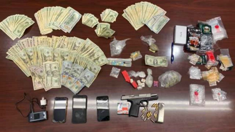 A man was arrested Wednesday and several drugs and cash were seized during a drug raid on North Mercer Street.