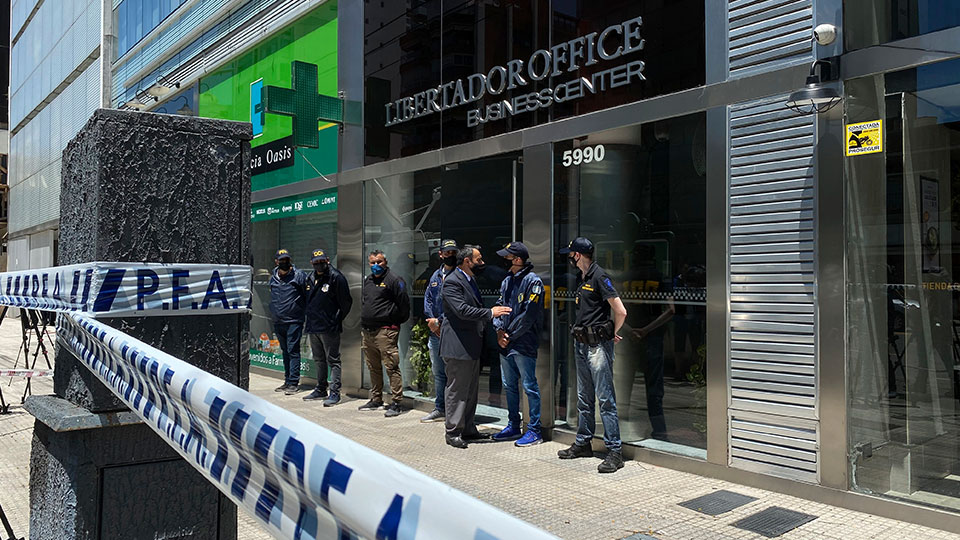 Police guard entrance to Dr. Leopoldo Luque's practice Buenos Aires, Argentina