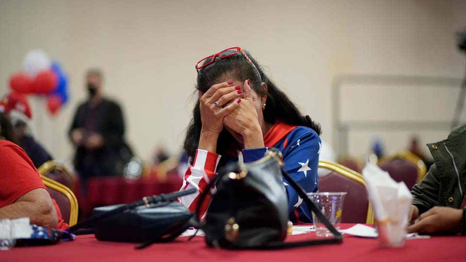 President Donald Trump supporter Loretta Oakes reacts while watching returns in favor of Democratic presidential candidate former Vice President Joe Biden, at a Republican election-night watch party, Tuesday, Nov. 3, 2020, in Las Vegas