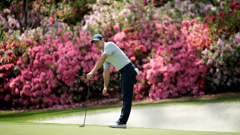 Rory McIlroy, of Northern Ireland, watches his putt on the 13th hole during a practice round for the Masters