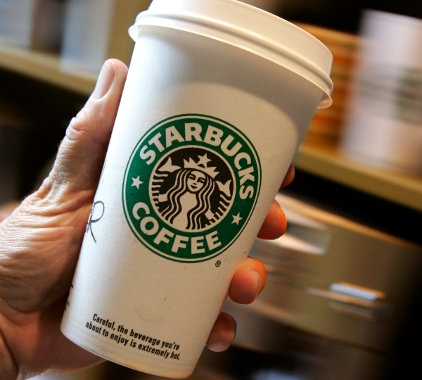 A customer holds their cup of coffee at the Starbucks in Chagrin Falls, Ohio on Wednesday, Aug. 2, 2006.