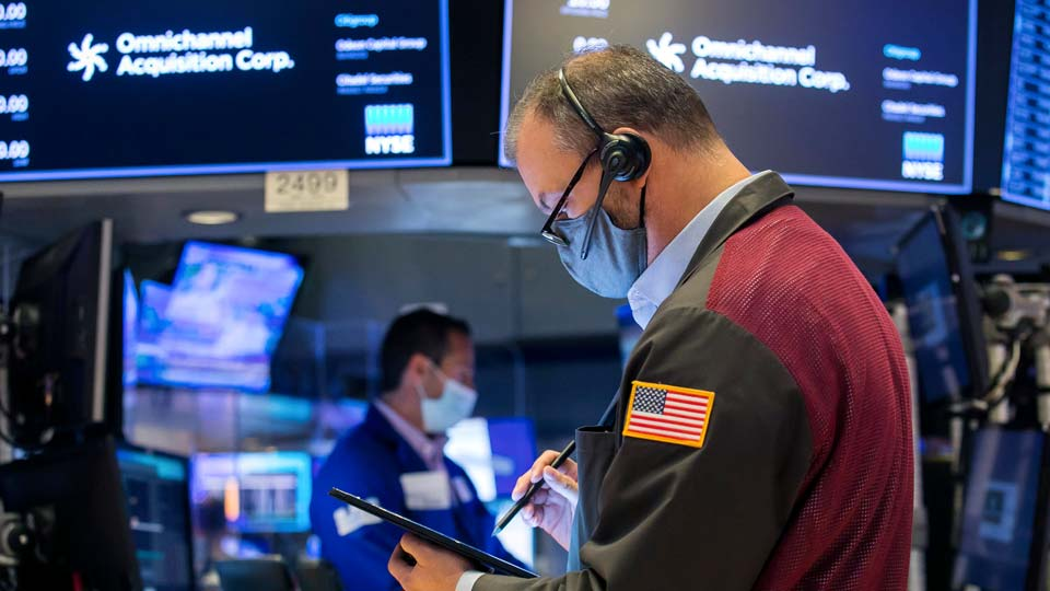 New York Stock Exchange, a trader works on the floor during the IPO of Omnichannel Acquisition Corporation, Friday, Nov. 20, 2020