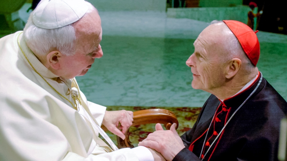 In this Feb. 23, 2001 file photo, U.S. Cardinal Theodore Edgar McCarrick, archbishop of Washington, D.C., shakes hands with Pope John Paul II during the General Audience with the newly appointed cardinals in the Paul VI hall at the Vatican.
