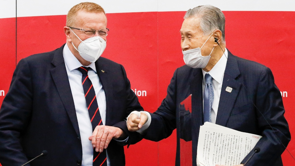 Yoshiro Mori, president of the Tokyo 2020 organizing committee, right, greets John Coates, chairman of the Coordination Commission for the Tokyo 2020 Olympics, during a press conference in Tokyo, Wednesday, Nov. 18, 2020.