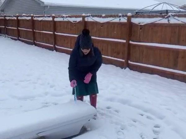 Alex George measures snowfall