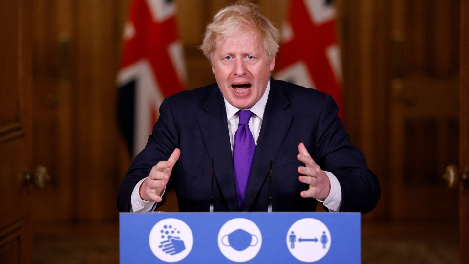"""FILE - In this Wednesday Dec. 2, 2020 file photo, Prime Minister Boris Johnson speaks during a news conference on the ongoing situation with the coronavirus pandemic, at Downing Street in London. On Friday, Dec. 18, 2020, The Associated Press reported on stories circulating online incorrectly asserting the COVID-19 vaccine contains the virus, based on comments by Johnson. He mistakenly said """"virus"""" instead of """"vaccine"""" when he said at the news conference, """"The virus has got to be stored at -70 degrees."""""""