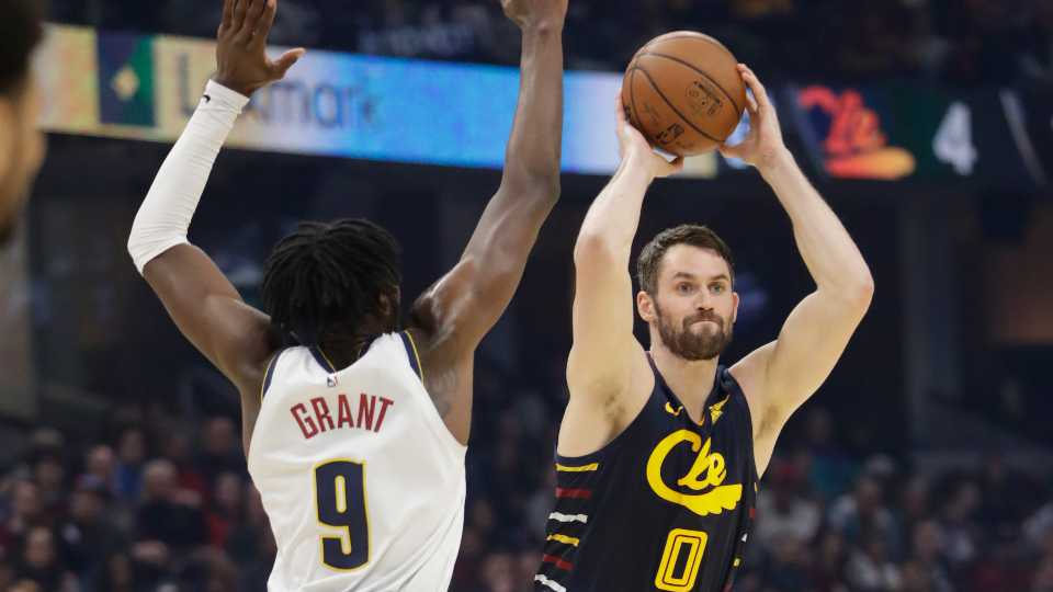 File-This March 7, 2020, file photo shows Cleveland Cavaliers' Kevin Love (0) passing against Denver Nuggets' Jerami Grant (9) in the first half of an NBA basketball game, in Cleveland. The NBA's interrupted season and invitation-only gathering in Florida to finish it due to the pandemic hurt every team to varying degrees. It devastated the Cleveland Cavaliers