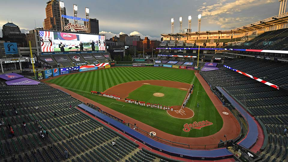 In this Sept. 29, 2020, file photo, players and coaches for the New York Yankees and the Cleveland Indians stand for the national anthem before Game 1 of an American League wild-card baseball series in Cleveland. The Indians are changing their name after 105 years, a person familiar with the decision told The Associated Press on Sunday, Dec. 13, 2020. After months of internal discussion prompted by public pressure and a national movement to remove racist names and symbols, the team is moving away from the name it has been called since 1915, said the person who spoke on condition of anonymity because the team has not revealed its plans.