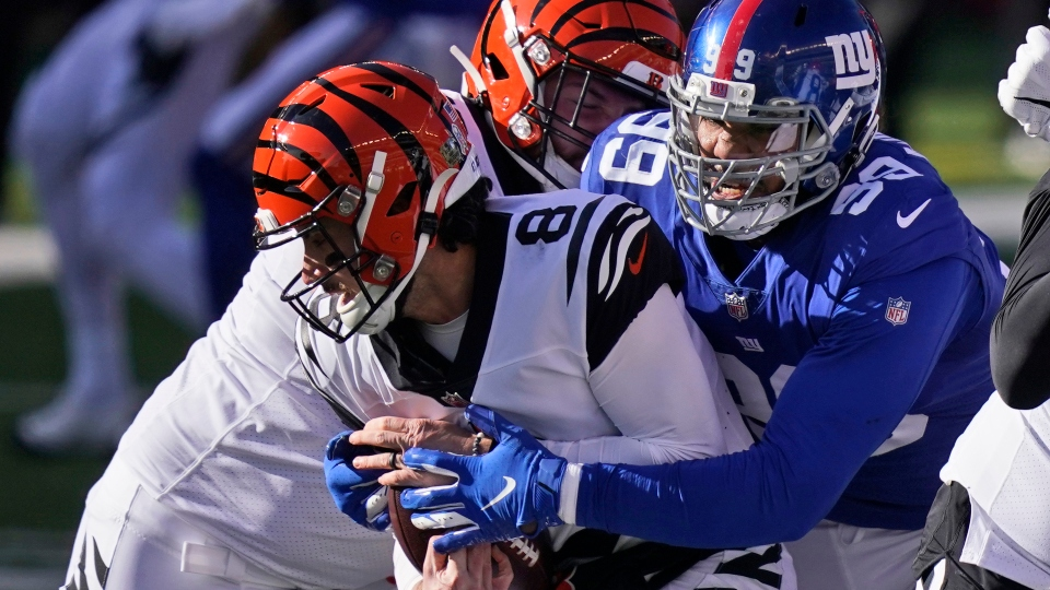 New York Giants defensive end Leonard Williams (99) tackles Cincinnati Bengals quarterback Brandon Allen (8) during the first half of an NFL football game, Sunday, Nov. 29, 2020, in Cincinnati.