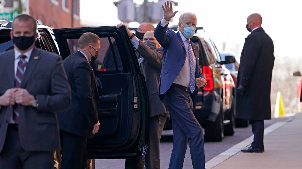 President-elect Joe Biden waves as he arrives at The Queen theater in Wilmington, Del., Monday, Dec. 7, 2020.