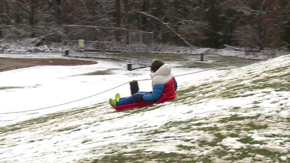 A thin layer of snow was all kids needed for some sled riding at Mill Creek Park on Wednesday.