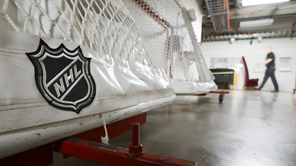 FILE - In this March 12, 2020, file photo, goals used by the NHL hockey club Nashville Predators are stored in a hallway in Bridgestone Arena in Nashville, Tenn. The National Hockey League and players reached a tentative deal Friday, Dec. 18, 2020, to hold a 56-game season in 2021, pending the approval of each side's executive board and Canadian health officials