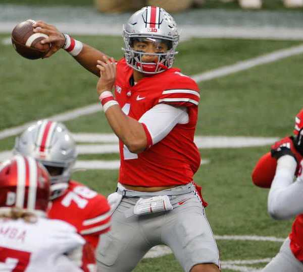 FILE - In this Nov. 21, 2020, file photo, Ohio State quarterback Justin Fields throws a pass against Indiana during the first half of an NCAA college football game in Columbus, Ohio. Fields repeated as offensive player of the year and is joined by three of his teammates on the Associated Press All-Big Ten football team.