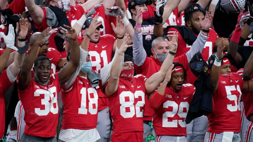 Members of Ohio State celebrate after defeating Northwestern in the Big Ten championship NCAA college football game, Saturday, Dec. 19, 2020, in Indianapolis. Ohio State won 22-10.