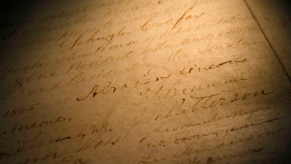 This Nov. 29, 2011, file photo shows the signature of president Abraham Lincoln on a rare, restored copy of the 13th Amendment that ended slavery, in Chicago.