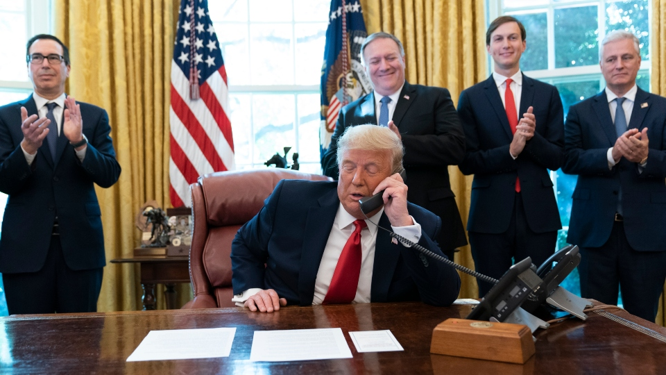 In this Oct. 23, 2020 file photo, President Donald Trump talks on a phone call with the leaders of Sudan and Israel.