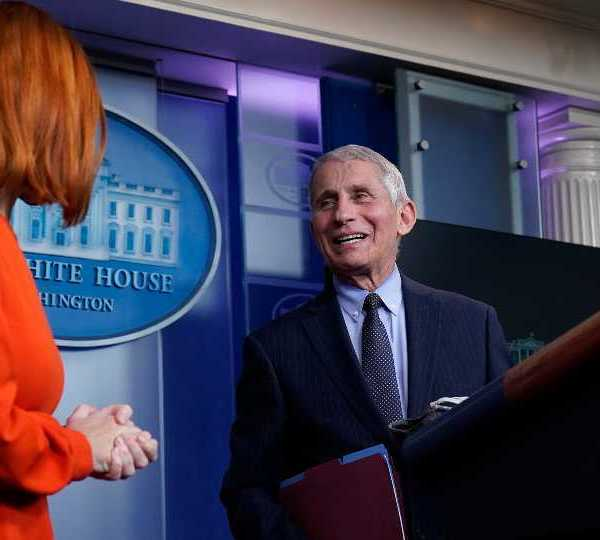 White House press secretary Jen Psaki speaks with Dr. Anthony Fauci, director of the National Institute of Allergy and Infectious Diseases, during a press briefing in the James Brady Press Briefing Room at the White House, Thursday, Jan. 21, 2021, in Washington