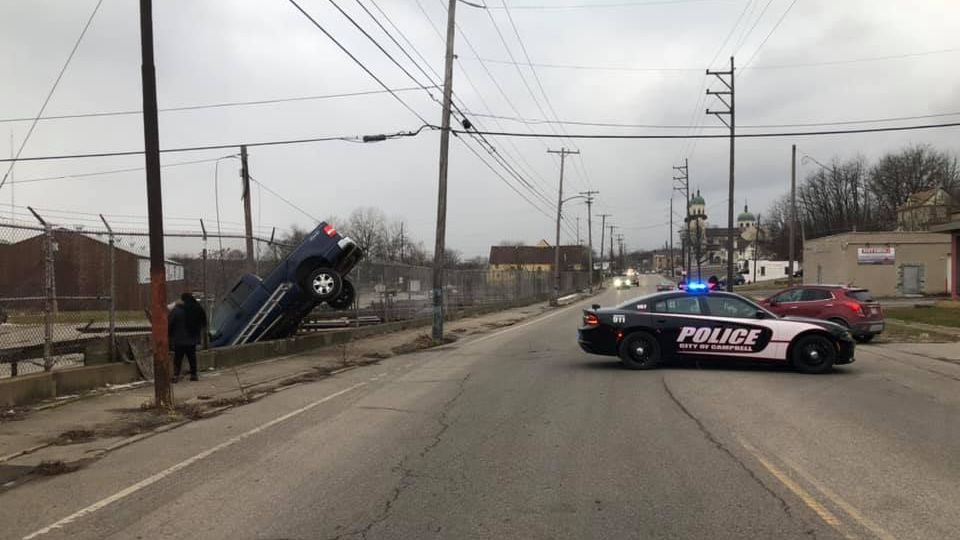 Campbell police are investigating after a pickup truck rolled down the hill and landed on a retaining wall.