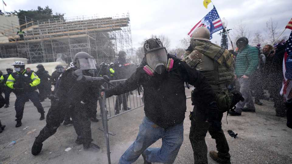 Trump supporters try to break through a police barrier, Wednesday, Jan. 6, 2021, at the Capitol in Washington. As Congress prepares to affirm President-elect Joe Biden's victory, thousands of people have gathered to show their support for President Donald Trump and his claims of election fraud. (