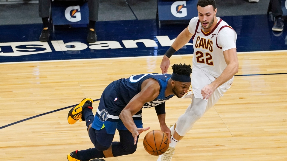 Minnesota Timberwolves' Josh Okogie, left, drives around Cleveland Cavaliers' Larry Nance Jr. (22) in the first half of an NBA basketball game Sunday, Jan. 31, 2021, in Minneapolis.