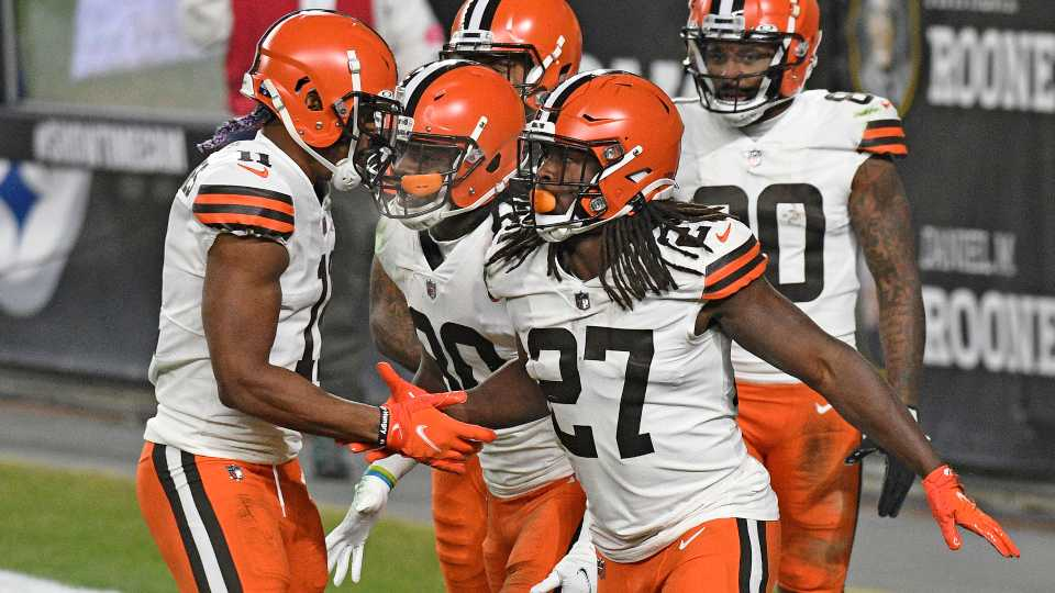 Cleveland Browns running back Kareem Hunt (27) celebrates after scoring on an 11-yard run during the first half of an NFL wild-card playoff football game against the Pittsburgh Steelers in Pittsburgh, Sunday, Jan. 10, 2021.