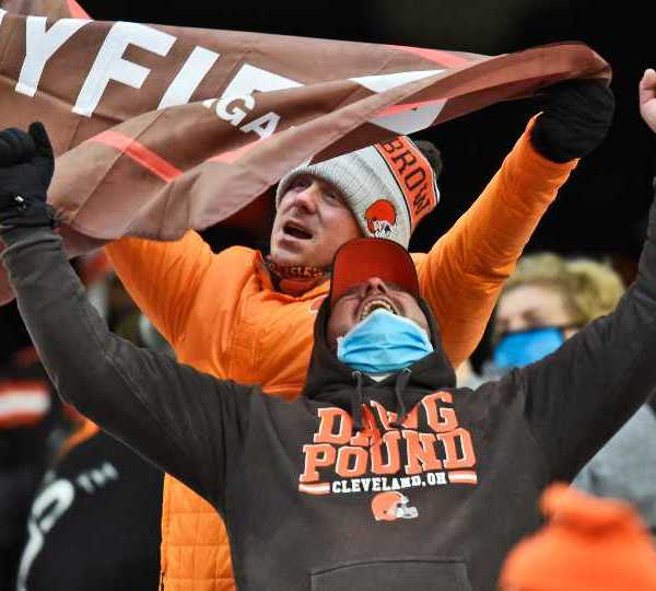 Cleveland Browns fans celebrate after the team defeated the Pittsburgh Steelers in an NFL football game, Sunday, Jan. 3, 2021, in Cleveland.