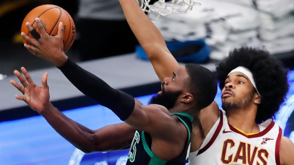 Boston Celtics' Jaylen Brown shoots against Cleveland Cavaliers' Jarrett Allen (31) during the first half of an NBA basketball game, Sunday, Jan. 24, 2021, in Boston.
