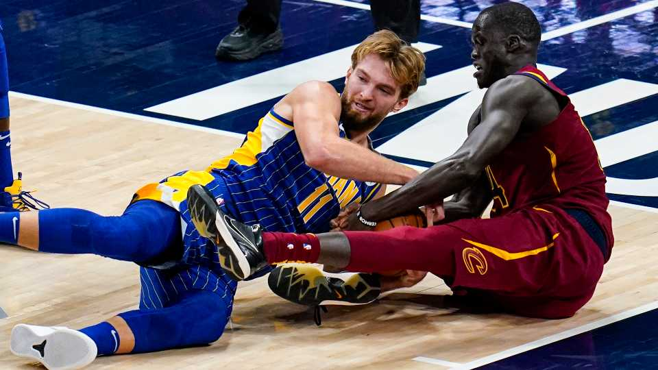 Indiana Pacers forward Domantas Sabonis (11) and Cleveland Cavaliers center Thon Maker (14) go to the floor for a loose ball during the second half of an NBA basketball game in Indianapolis, Thursday, Dec. 31, 2020.
