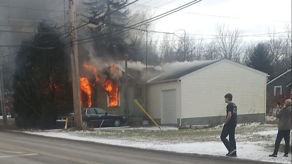 Crews worked Friday afternoon to control a fire at a home in Columbiana.