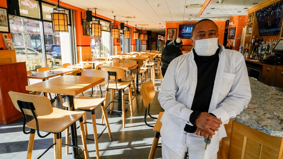 Andrew Walcott, owners of Fusion East Caribbean & Soul Food restaurant, poses for a photo at the restaurant in East New York neighborhood of the Brooklyn borough of New York, Thursday, Jan. 7, 2021.