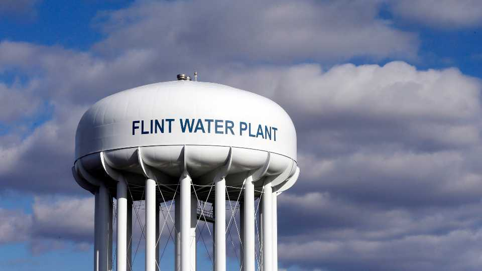 In this March 21, 2016, file photo, the Flint Water Plant water tower is seen in Flint, Mich. Former Michigan Gov. Rick Snyder, Nick Lyon, former director of the Michigan Department of Health and Human Services, and other ex-officials have been told they're being charged after a new investigation of the Flint water scandal, which devastated the majority Black city with lead-contaminated water and was blamed for a deadly outbreak of Legionnaires' disease in 2014-15, The Associated Press has learned.
