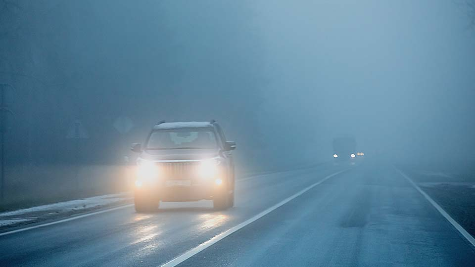 A foggy road with low visibility.