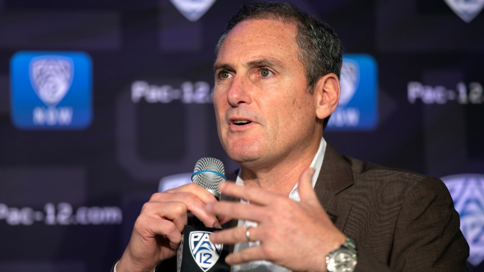In this Oct. 7, 2019, file photo, Pac-12 Commissioner Larry Scott speaks to reporters during the Pac-12 Conference women's NCAA college basketball media day in San Francisco.