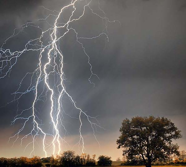 Lightning striking during a thunderstorm.