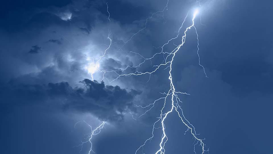 Lightning striking during a thunderstorm.