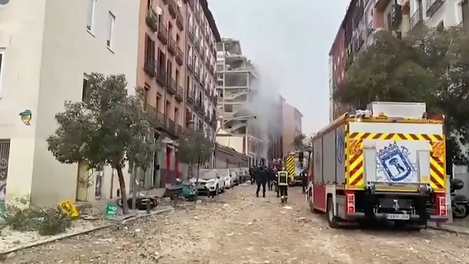 A loud explosion has partially destroyed a small building flanked by a school and a nursing home in the center of Spain's capital.