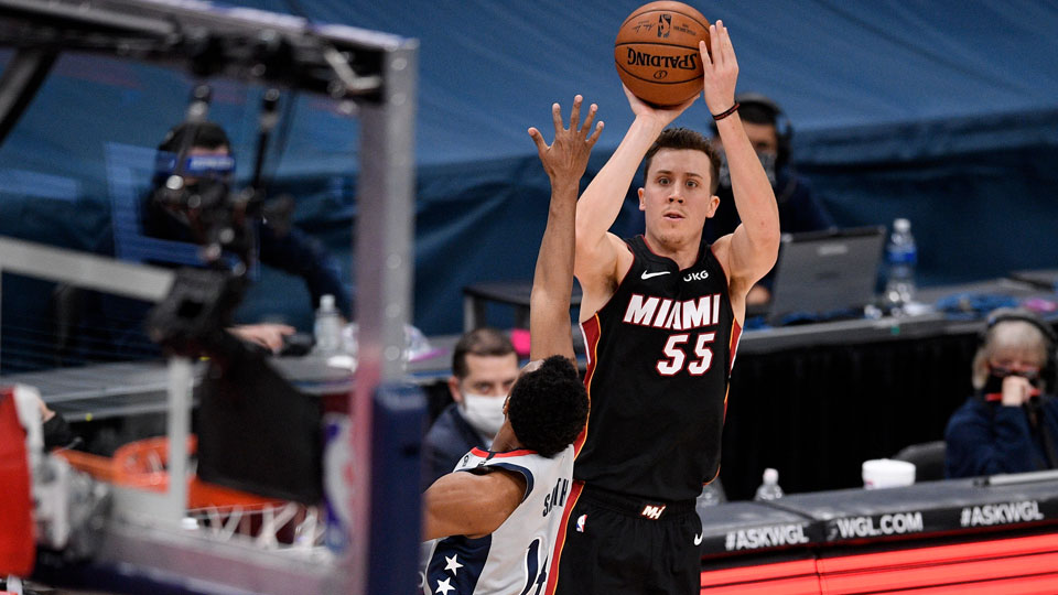 Miami Heat guard Duncan Robinson (55) shoots as he is defended by Washington Wizards guard Ish Smith (14)