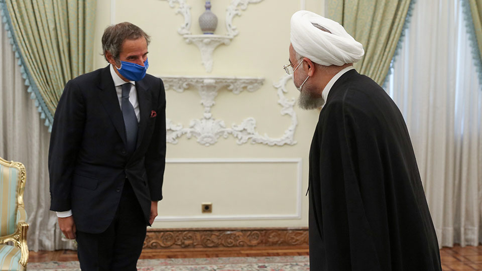 President Hassan Rouhani, right, welcomes Director General of International Atomic Energy Agency, IAEA, Rafael Mariano Grossi