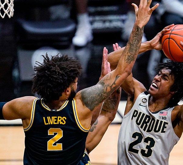 Purdue guard Jaden Ivey shoots over Michigan forward Isaiah Livers