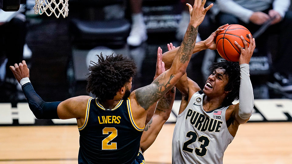 Purdue guard Jaden Ivey shoots over Michigan forward Isaiah Livers