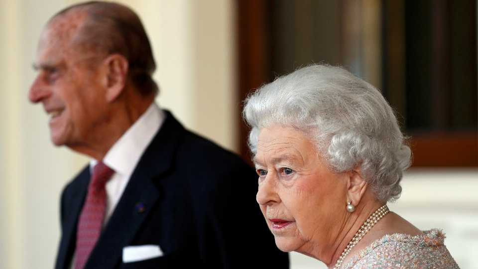 FILE - In this Thursday, Nov. 3, 2016 file photo, Britain's Prince Philip and Queen Elizabeth II bid farewell to Colombia's President Juan Manuel Santos, and his wife Maria Clemencia de Santos, following their state visit, at Buckingham Palace in London. Queen Elizabeth II and her husband have received their COVID-19 vaccinations. Buckingham Palace officials said in a statement that the 94-year-old monarch and 99-year-old Prince Philip received their jabs on Saturday, Jan. 9, 2021, joining some 1.5 million people in Britain who have been given the first dose of a vaccine against the coronavirus
