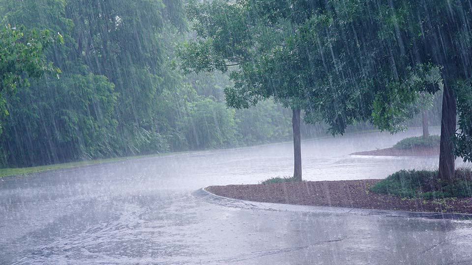 Rain drops creating flooding during a storm.