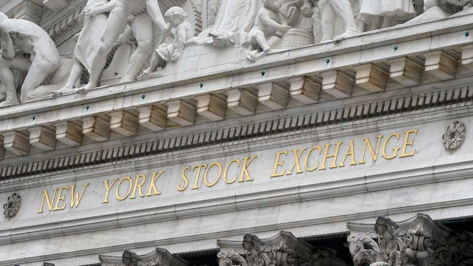 FILE - In this Nov. 23, 2020 file photo, stone sculptures adorn the New York Stock Exchange. Stocks are pulling lower again on Friday, Jan. 15, 2021, after reports showed the pandemic is deepening the hole for the economy, as Washington prepares to throw it another lifeline.