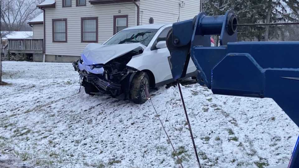 An SUV slid off the road and into the side of a house on State Route 305 in Warren Saturday.