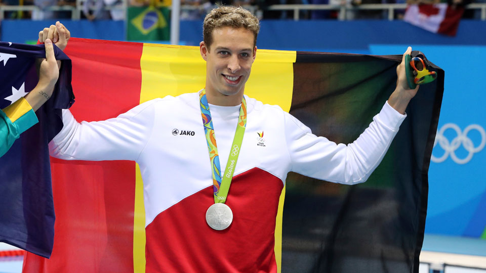 Belgium's Pieter Timmers holds up his silver medal after the men's 100-meter freestyle