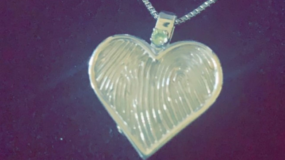 A Struthers woman lost this necklace containing her dad's ashes and thumbprint, and is looking for helping finding it