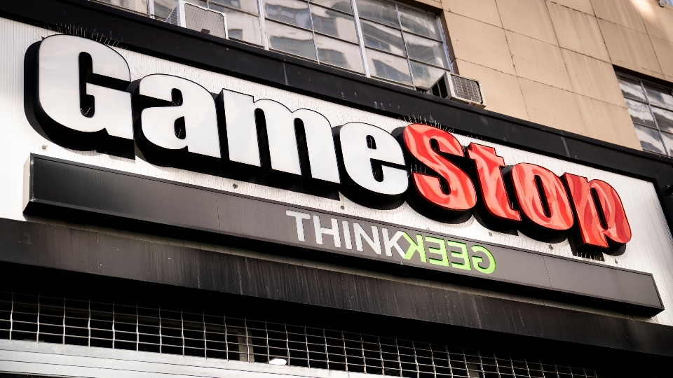Pedestrians pass a GameStop store on 14th Street at Union Square, Thursday, Jan. 28, 2021, in the Manhattan borough of New York.